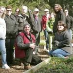 twelve people in a garden
