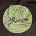 Wiggle shirt design on a brown hoodie