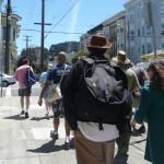 Tour walking on sidewalk