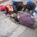 People listening at sewer on Clayton at Pemberton