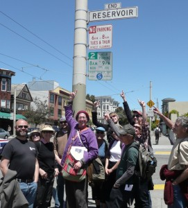 group with Reservoir Street sign
